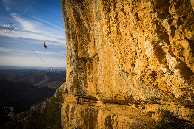 February 2, 2017: Climber swinging from climbing rope, Magaluf, Catalonia, Spain