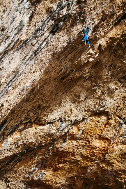 February 3, 2017: Climber hanging upside down from roof of Santa Linya cave, Catalonia, Spain
