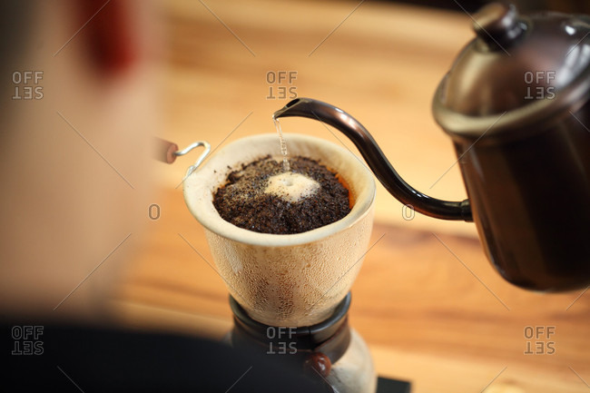 Percolating coffee by pouring water, Oakland, USA