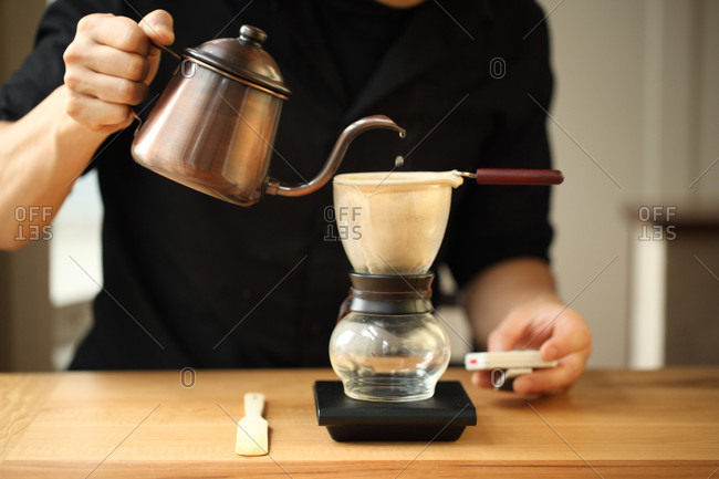 Percolating coffee by men in black shirt, Oakland, USA