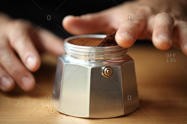 Close up of ground coffee in silver container, Oakland, USA