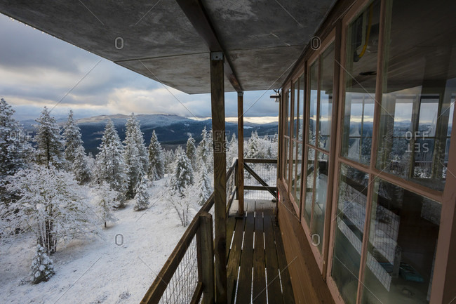 Snowy winter landscape of forest with mountains view from top of Pickett Butte Fire Lookout near Tiller, Oregon, USA