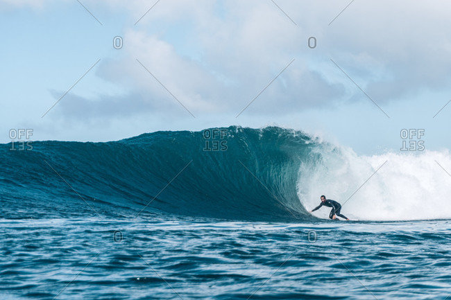 Surfer riding wave, Fuerteventura, Canary Islands, Spain
