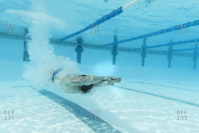 April 11, 2017: Underwater view of Olympic swimmer training in pool, Tenerife, Canary Islands, Spain