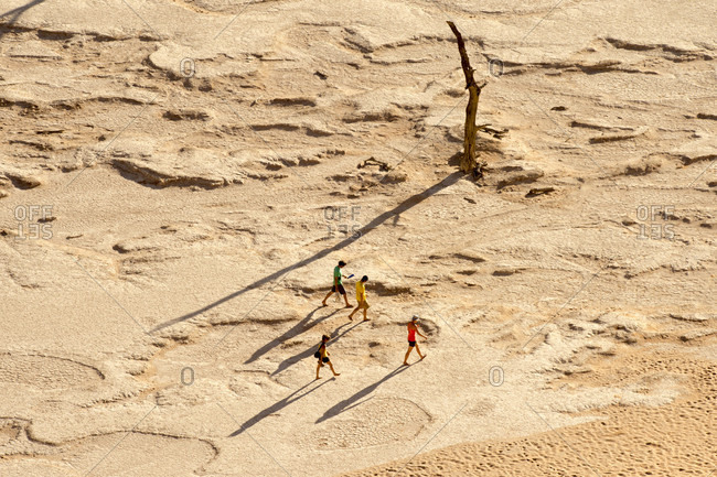 August 23, 2014: Four tourists crossing desert in Namib Naukluft National Park, Namibia