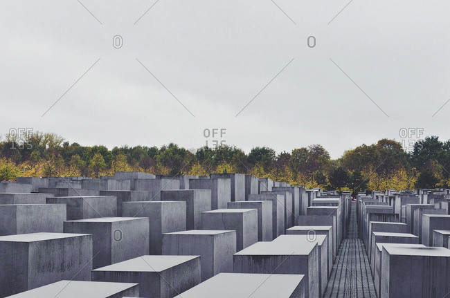Germany, Berlin - October 22, 2014: Holocaust Memorial by trees against clear sky