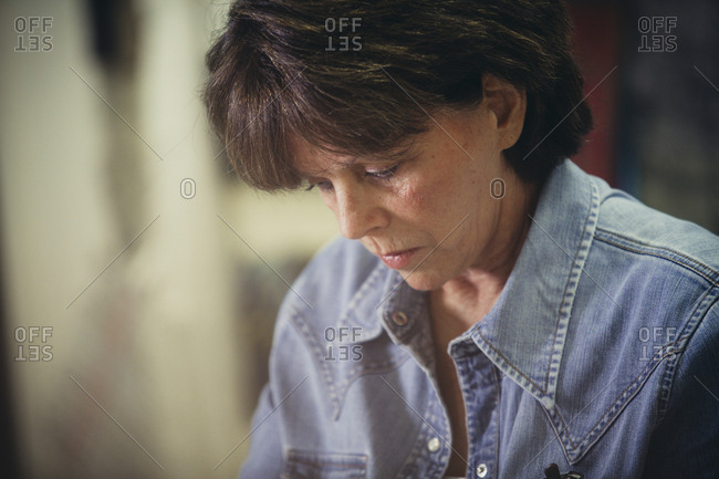 Serious craftswoman working at workshop