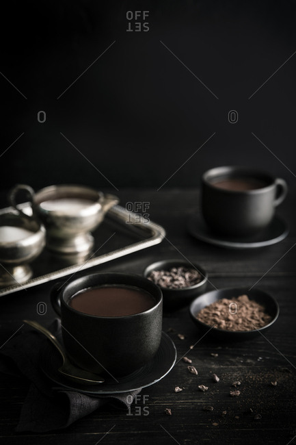 Two cups of hot chocolate on a wood table