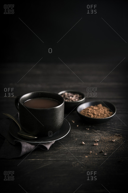Cup of hot chocolate on a dark wood table
