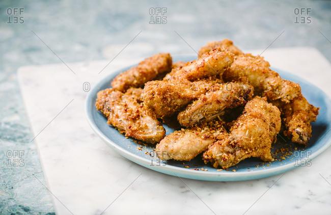 Plate of crispy seasoned chicken wings