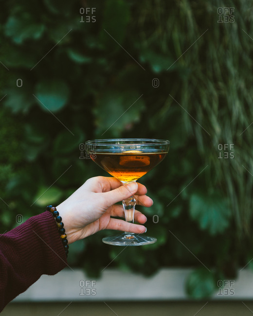 A girl hand and cocktail