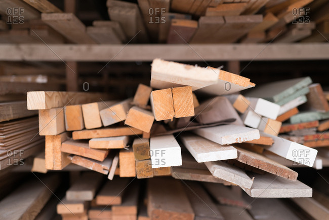 Piles of cut wood stored in shelving unit