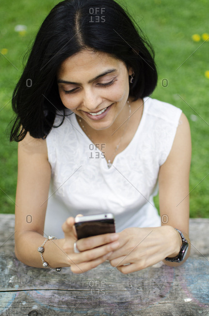 Portrait of South Asian woman checking her mobile phone