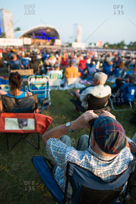 Festival goers sit in anticipation of the main stage concert