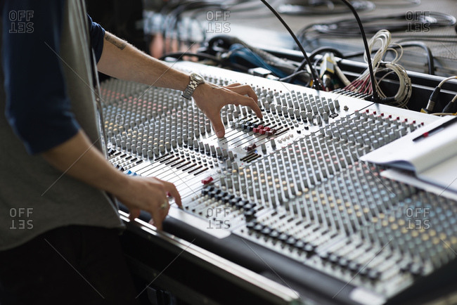 Details of sound equipment being operated by stagehand