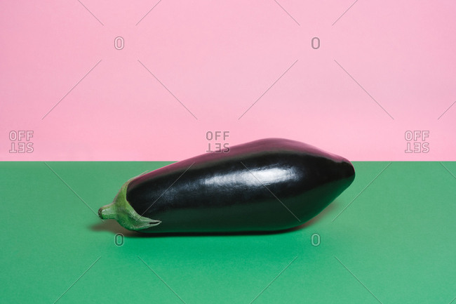 Eggplant on a colorful red and pink background