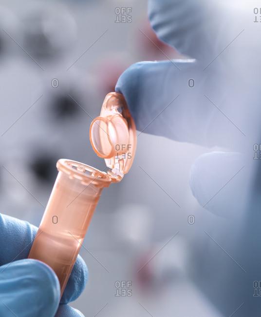 Scientist closing the eppendorf tube