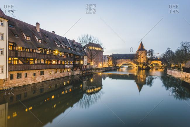 February 6, 2018: Germany- Bavaria- Nuremberg- Old town- Hallertor Bridge- Pegnitz river at blue hour