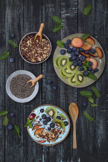 Superfood smoothie bowl with chia seeds- blueberries- nectarine- kiwi and chocolate granola