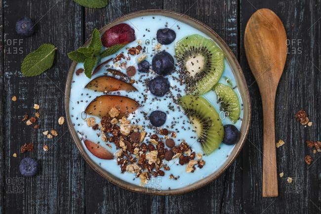 Superfood smoothie bowl with chia seeds- blueberries- nectarine- kiwi and chocolate granola