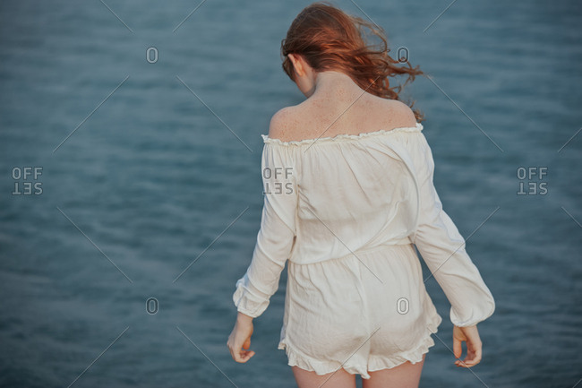 Redhead teenage girl at the Atlantic ocean