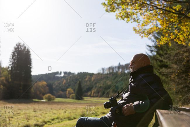 Mature man at rest enjoying nature in autumn
