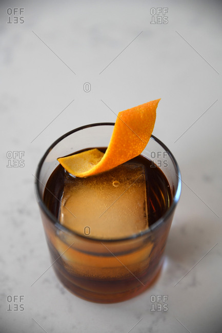 Cocktail served with orange peel