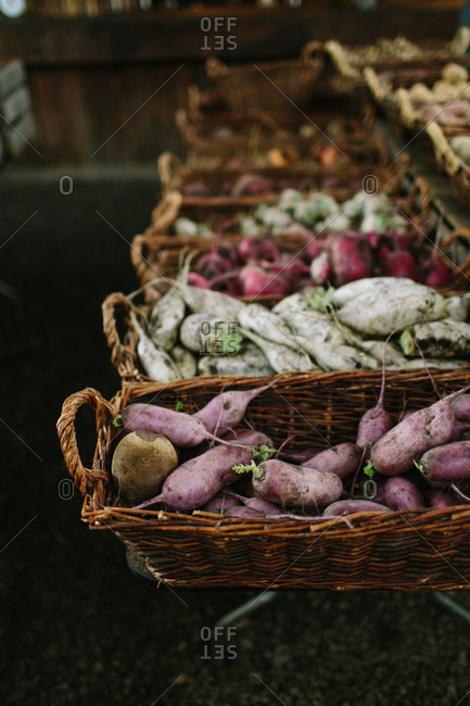 Variety of root vegetables displayed in baskets