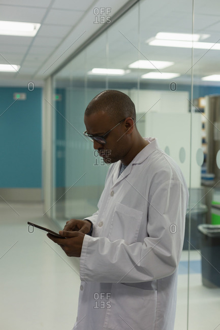 Scientist using digital tablet in science lab