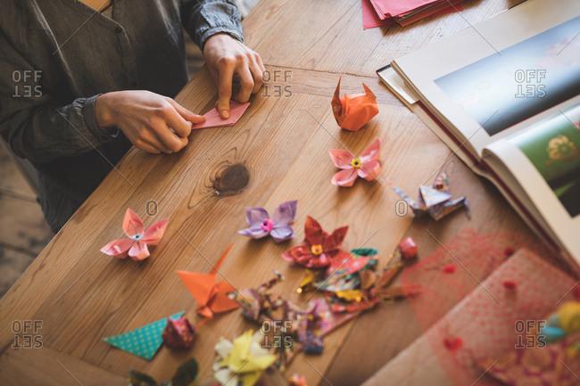 Woman preparing a paper craft at home