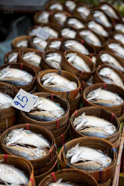 Fresh mackerels in Maeklong railway market, the famous railway market in Bangkok, Thailand
