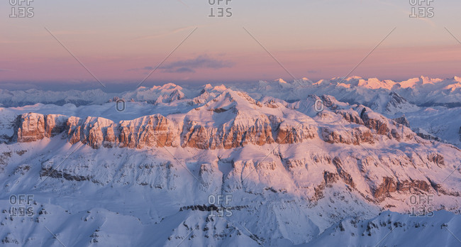 Wonderful sunrise from Marmolada mountain group, the highest peak of Dolomites, toward the Sella peak lighting, dolomites, Italy