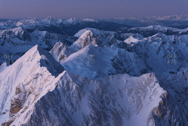 Sunrise from Punta Penia in the Marmolada mountain group, the highest peak of Dolomites, Italy