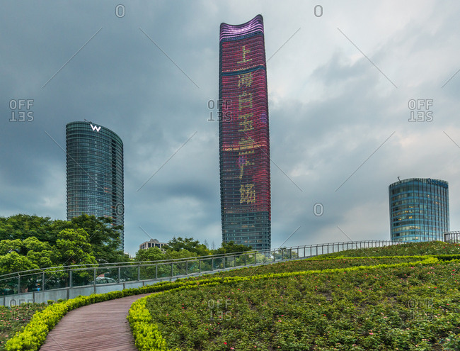 September 5, 2017: Shanghai commercial district modern urban architecture and green city park, China