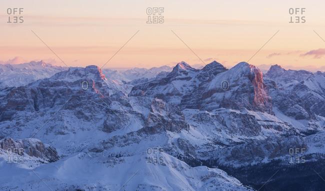 Sunrise from Marmolada mountain group, the highest peak of Dolomites, toward the Tofana di Rozes illuminated, dolomites, Italy
