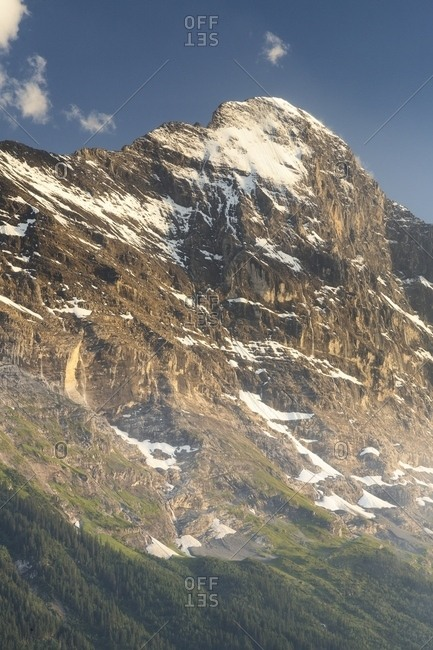 Sunset on Jungfrau mountain group and Eiger mount from Grindelwald village, Berner Oberland, Switzerland, Europe