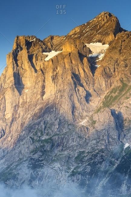 Sunset on Jungfrau mountain group from Grindelwald village, Berner Oberland, Switzerland, Europe