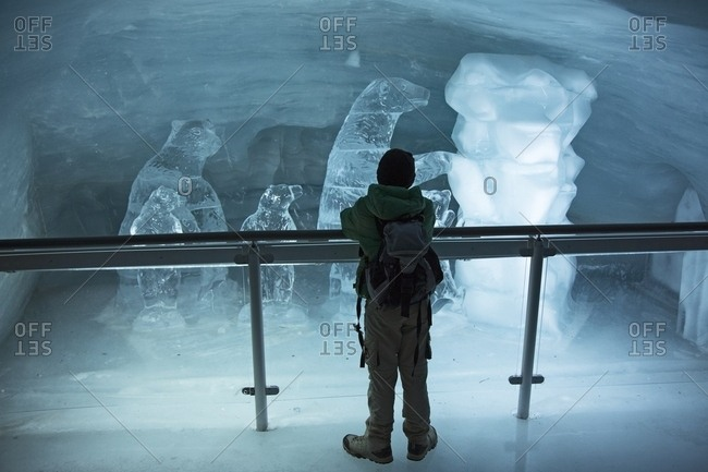 August 5, 2013: Child admiring the ice sculptures in the museum on the top of Jungfraujoch, the highest railway station in the Alps, Aletsch glacier, Bernese alps, Switzerland, Europe