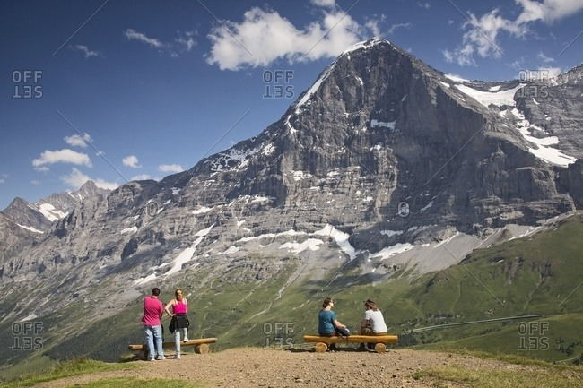 Tourists admiring the famous north face of Eiger mount, Mannlichen, Grindelwald, Berner Oberland, Switzerland, Europe