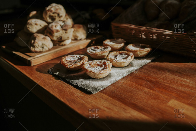 Fresh baked pastries on shady wooden counter