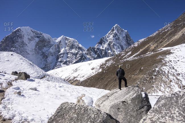 Hiker enjoying view, Everest Trek, Khumbu Valley, Nepal