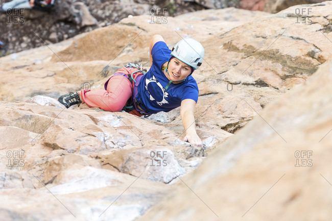 High angle portrait of tired female hiker on mountain