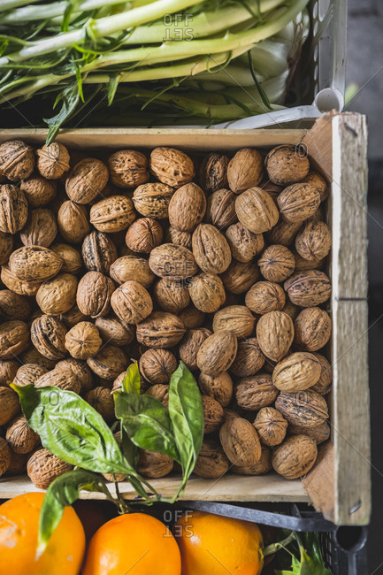 Overhead view of walnuts for sale in crate at market stall