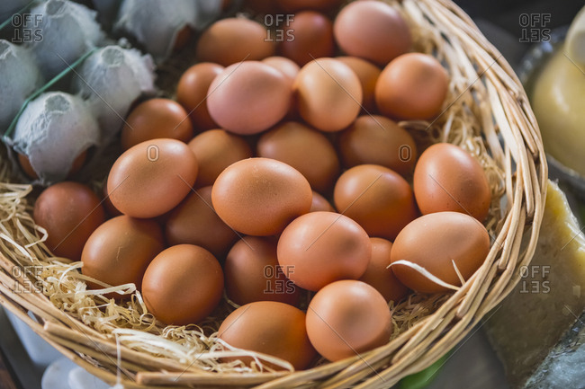 Close-up of brown eggs in basket for sale at market stall