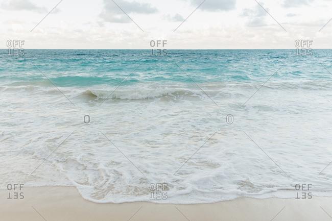 Waves gently breaking on flawless beach in Hawaii