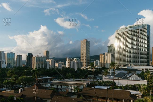 Tropical sunset illuminating high rise buildings of Honolulu, Hawaii