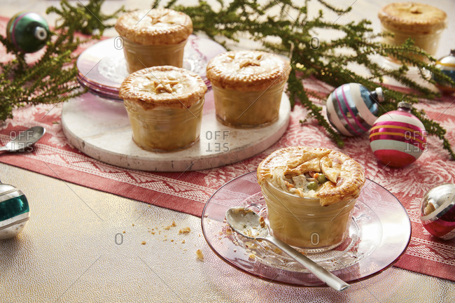 Personal chicken pot pies arranged with Christmas decorations