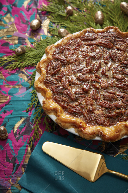 High angle view of whole pecan pie on festive table setting