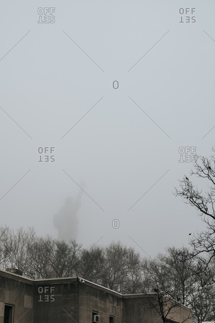 Rearview of Statue of Liberty shrouded in fog