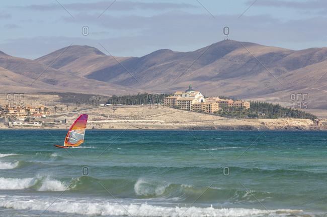 December 28, 2017: Wind-surfer off Playa de La Barca, Costa Calma, on the volcanic island of Fuerteventura, Canary Islands, Spain, Atlantic, Europe